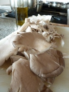 Shredding oyster mushrooms for paella